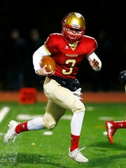 Mount Olive quarterback Liam Anderson heads to the