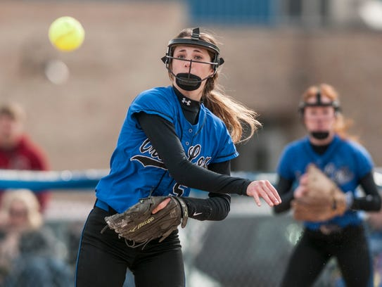 Cros-Lex's Clare Knapp throws the ball to first for
