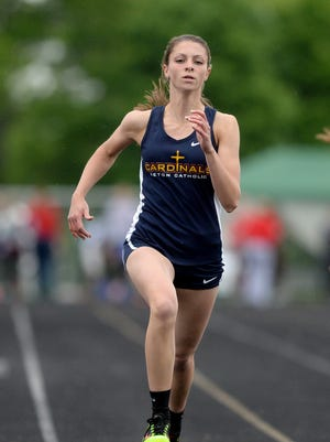 Seton Catholic's Julia Reichley runs in the 100m dash prelims during the girls track and field sectional Tuesday, May 17, 2016 in Connersville.