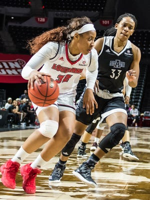 UL forward Simone Fields (32) drives to the basket during the Cajuns' home win over Arkansas State on Thursday at the Cajundome.