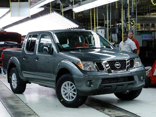 A Nissan truck rolls off the assembly line at the Canton, Miss., assembly plant.