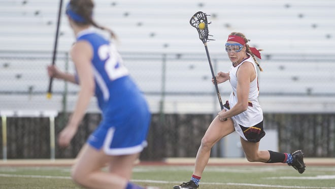 Madeleine Mason is a team captain and one of the scoring leaders for the Rocky Mountain girls lacrosse team, a first-year program. Mason is also a swimming star at Fossil Ridge.