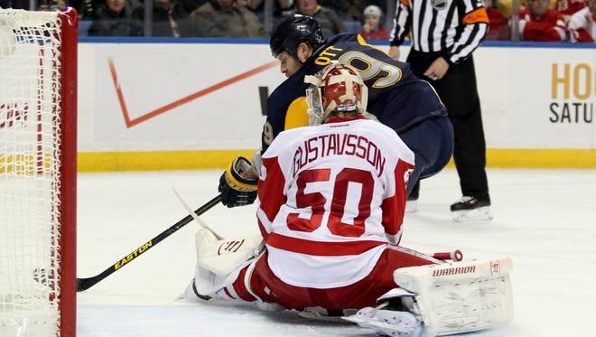 Detroit Red Wings goalie Jonas Gustavsson stops Buffalo Sabres center Steve Ott on a second-period penalty shot on Sunday.