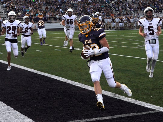 Cason Grant runs the ball into the end zone for Wylie