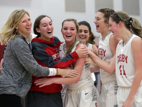 Shelby's Kennadie Goth (third from the left) celebrates