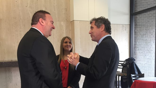 Tim Massa, Group Vice President, Human Resources and Labor Relations for Kroger, Stephanie Anderson, a Kroger employee who qualified for a raise under the Department of Labor overtime pay rule and U.S. Sen. Sherrod Brown talk after a press conference on Jan. 6, 2017 at Kroger Headquarters in Cincinnati.