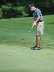 Northeastern's Garrett Schuler strokes a putt during the boys golf sectional at Forest Hills Country Club Monday, June 6, 2016.