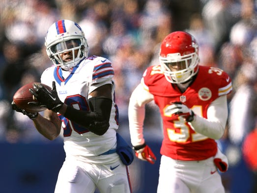 Bills' rookie receiver Marquise Goodwin catches a 59-yard touchdown pass behind Chiefs Marcus Cooper (31).