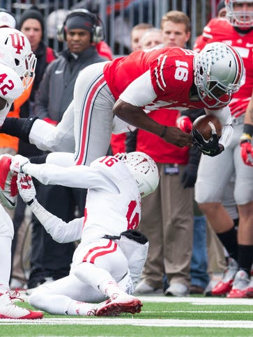 Ohio State quarterback J.T. Barrett is tackled by Indiana