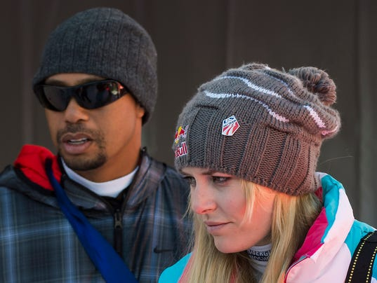 2013-12-21-tiger-woods-lindsey-vonn-race
