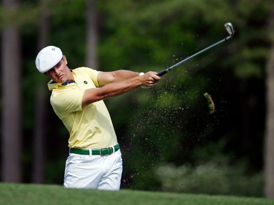 Amateur Bryson DeChambeau tees off on the 12th hole during the second round of the Masters golf tournament Friday, April 8, 2016, in Augusta, Ga. (AP Photo/Charlie Riedel)