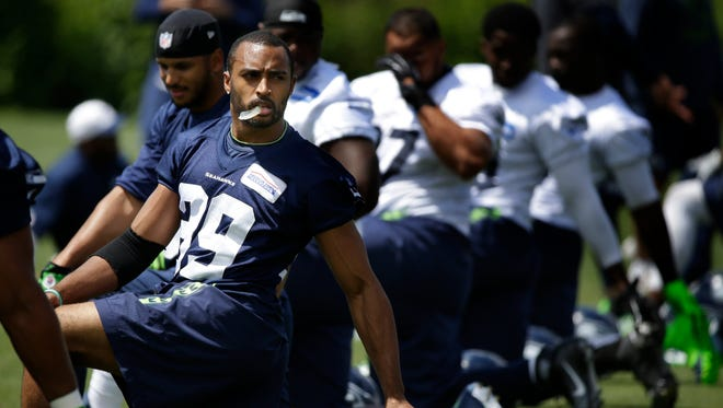 Seattle Seahawks wide receiver Doug Baldwin, left, stretches with teammates during NFL football practice, Wednesday, June 15, 2016, in Renton, Wash.