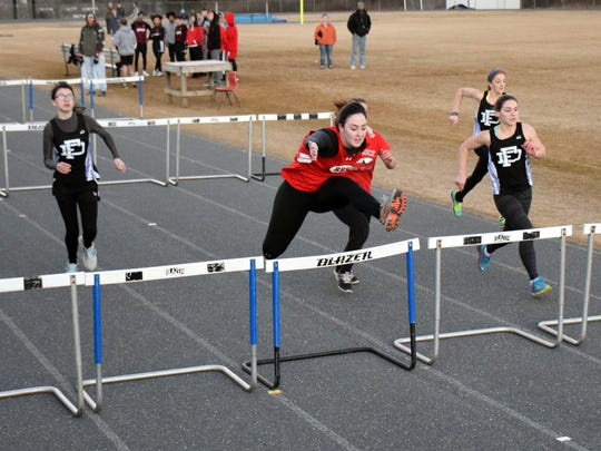 Riverheads' Shelby Smiley, second from right, leads the field during a heat of the 55-meter hurdles at a Polar Bear track meet at Fort Defiance High School on Wednesday, Jan. 18, 2017.