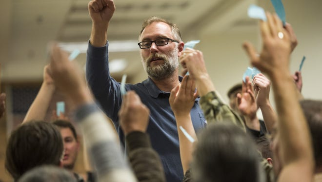 A volunteer takes a count during a crowded Democratic caucus at Rocky Mountain High School in Fort Collins Tuesday , March 1, 2016.