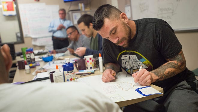 J.J. Zepp, participating in a 21-day rehabilitation program, works in a group exercise at Larimer County Community Corrections on Thursday. Larimer County is filling budget gaps from the state that would have contributed to salaries for staff at the facility.