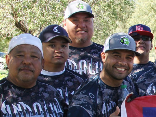 The Sindalu Guahan master's softball team displays the Guam flag after finishing ninth overall Oct. 24 amongst 24 teams in the LVSSA/SSUSA World Masters Championship 2015, Men's 40-plus Masters AAA Division, in Las Vegas, Nevada.