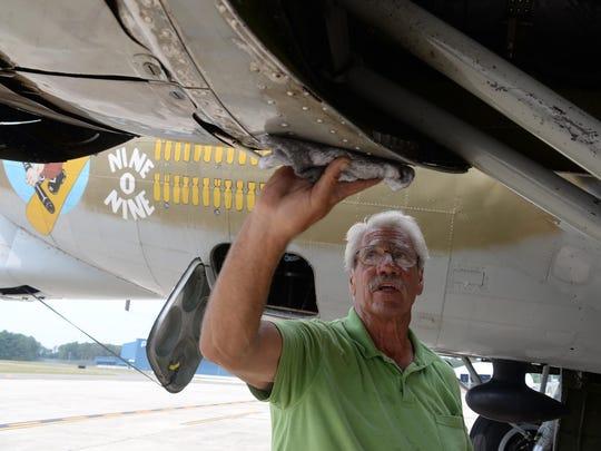 B-17 pilot Mac McCauley inspects the bomber after landing