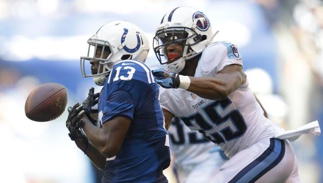 Titans cornerback Blidi Wreh-Wilson breaks up a pass to Colts wide receiver T.Y. Hilton on Sunday.