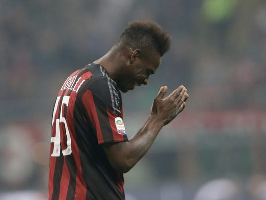 AC Milan's Mario Balotelli gestures after missing a scoring chance during a Serie A soccer match between AC Milan and Juventus, at the San Siro stadium in Milan, Italy, Saturday, April 9, 2016. (AP Photo/Luca Bruno)