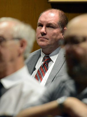 Lancaster Mayor Brian Kuhn sits in the back of the courtroom during his wife's change of plea hearing Monday, June 6, 2016, in Fairfield County Common Pleas Court in Lancaster. Bridget Kuhn faces up to 19 1/2 years in prison after she pleaded guilty to 11 counts related to embezzling more than $320,000 from a local business and a local veterans group.