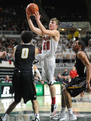 Fairfield Union's Hayden Price takes a shot over a Miami Trace opponent Friday at the Convocation Center in Athens.