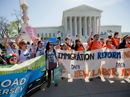 In this April 18, 2016, file photo, supporters of fair immigration reform gather in front of the U.S. Supreme Court in Washington. Supreme Court decisions in a half-dozen cases dealing with immigration over the next two months could reveal how the justices might evaluate Trump administration actions on immigration, especially stepped up deportations.