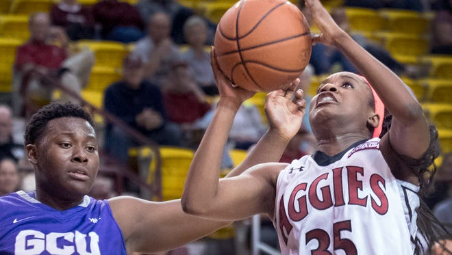 New Mexico State's Moriah Mack (35) puts up an off balance shot after getting around Grand Canyon's Zelor Massaquoi Sunday afternoon at the Pan American Center.