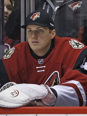 Coyotes' Nathan Schoenfeld, sits on the bench after only being signed a couple hours before to play backup for Coyotes' goalie Louis Domingue after an injury to Anders Lindback at Gila River Arena in Glendale, Ariz., on Monday, February 15, 2016.