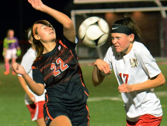 Susquehannock's Mia Dills heads the ball with Northeastern's