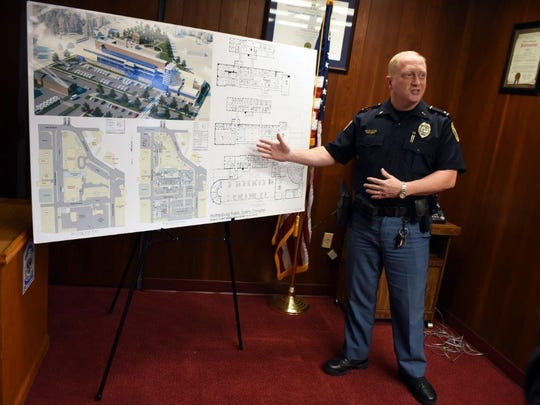 Former HPD spokesman Lt. Jon Traxler shows plans for the upcoming Public Safety Complex at a news conference on Tuesday, July 18, 2017.