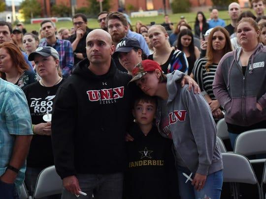 People hug during Nashville Candelight Vigil for Las
