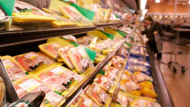 Packages of chicken are shown in this file photo of a grocery store.