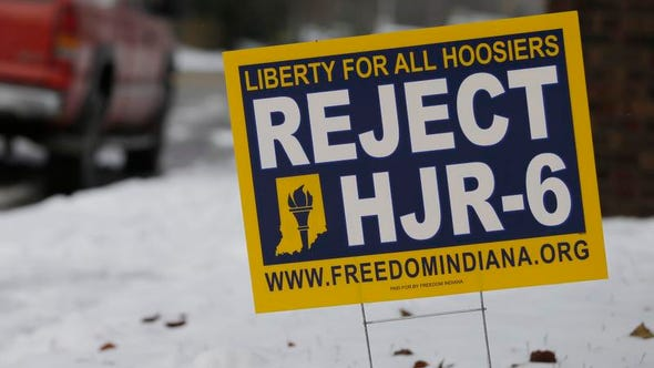 This Dec. 17, 2013, photo shows a yard sign in Indianapolis. Indiana lawmakers will decide whether to ask voters to amend the constitution to ban same-sex marriage when they reconvene in January. (AP Photo/Darron Cummings)