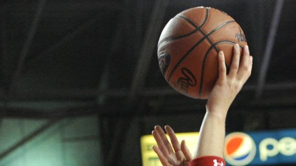Rockcastle County's Sara Hammond, right, shoots over Madison Central's Kristin Congleton on Thursday, March 10, 2011, in a KHSAA Girls'†Sweet†16 state basketball tournament game at Diddle Arena in Bowling Green, Ky. (AP Photo/Joe Imel)