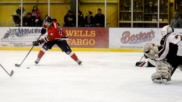 Great Falls Americans' Aaron McInnis controls the puck in front of the Bozeman goal during last Friday night's game at the IcePlex. TRIBUNE PHOTO/RION SANDERS