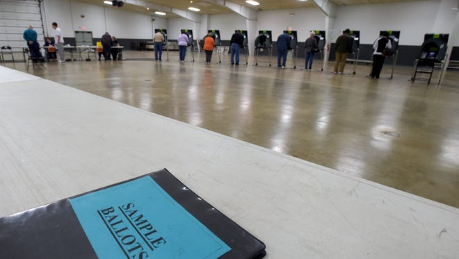 Voters cast their ballots Saturday, Oct. 29, 2016 at the Kuhlman Center at the Wayne County Fairgrounds in Richmond.