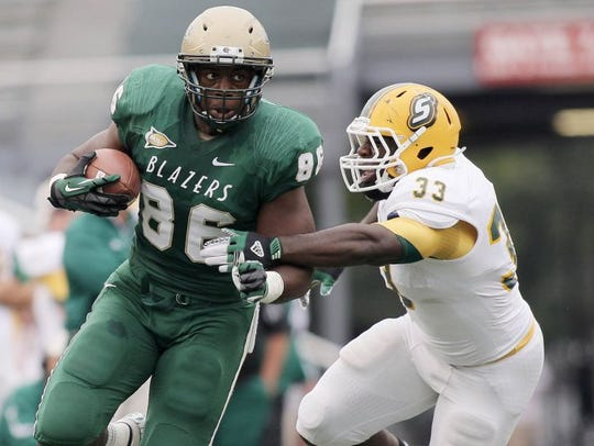 UAB tight end Kennard Backman, left, was the last of
