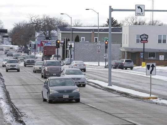 Vehicles travel down Oshkosh Avenue at North Sawyer Street Jan. 3 in Oshkosh. City officials hope to redevelop the area.