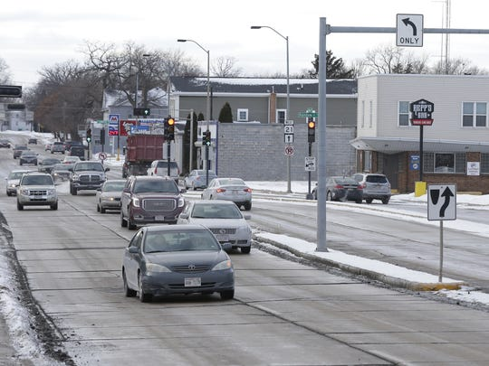 Vehicles travel down Oshkosh Avenue at North Sawyer