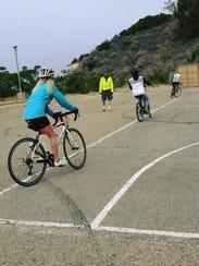 Participants practice bike drills behind Ventura City