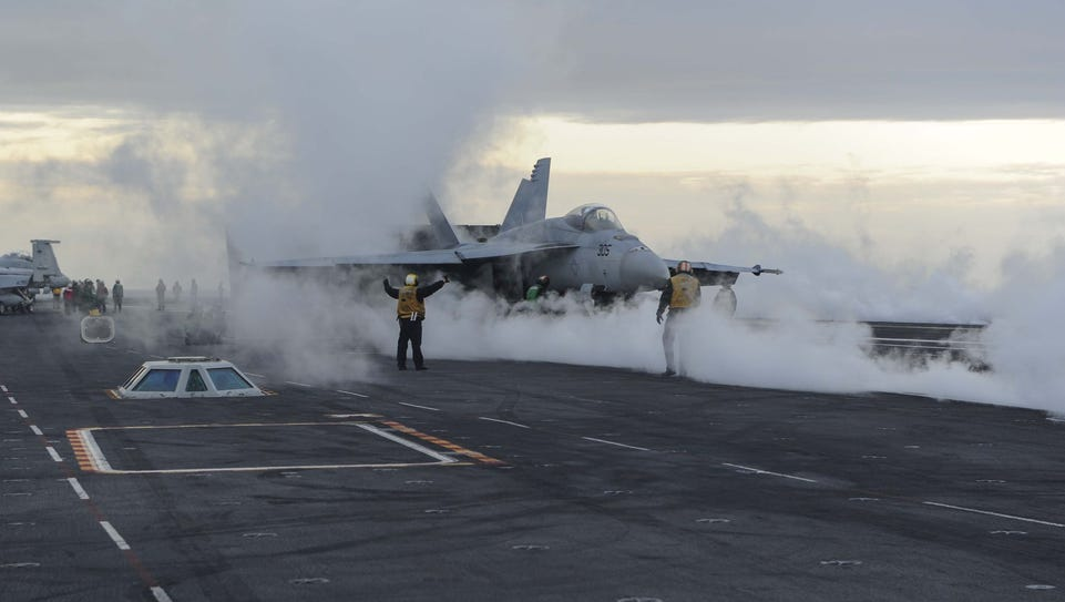 A US Navy F/A-18F Super Hornet readies for launch from
