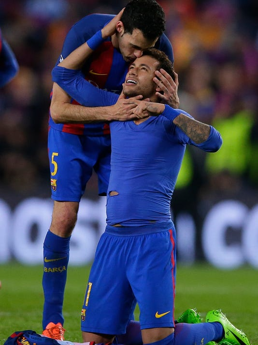 Barcelona's Neymar, right, celebrates with Barcelona's Sergio Busquets at the end of the Champions League round of 16, second leg soccer match between FC Barcelona and Paris Saint Germain at the Camp Nou stadium in Barcelona, Spain, Wednesday March 8, 2017. Barcelona won the match 6-1 (6-5 on aggregate). (AP Photo/Manu Fernandez)
