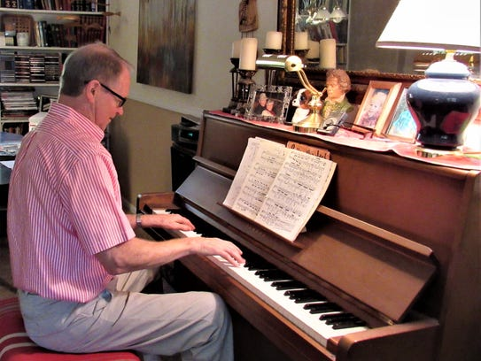 Playing his mother's piano, Frank Galbraith performed