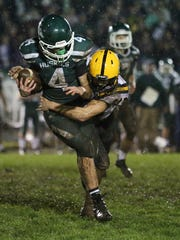 Cascade's Cota Wakem tries to take down North Marion's