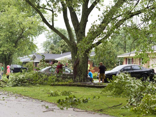 Several trees in a neighborhood near County Road 550 East and Hammon Drive, near Brownsburg, sustained significant damage Monday, Aug. 15, 2016. The National Weather Service is investigating as many as six possible tornadoes that tore across parts of Central Indiana.