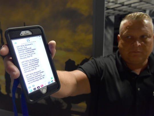 James Billig, of ASR Alert Systems, shows a sample