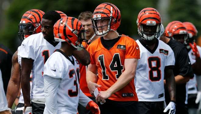 Cincinnati Bengals quarterback Andy Dalton (14) sets up the offense for a drill during practice in the second week of OTAs at the Cincinnati Bengals practice facility in downtown Cincinnati on Tuesday, May 29, 2018.