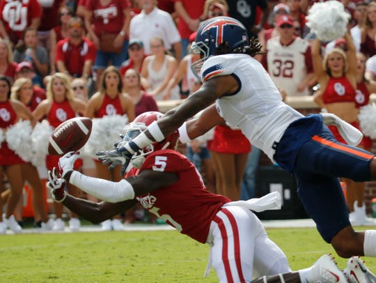 Defensive end Kaylon Beverly sticks with the play and