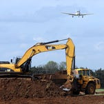 A plane Thursday comes in for a landing at the Murfreesboro Municipal Airport as an extension to the runway, which began last week, is underway.