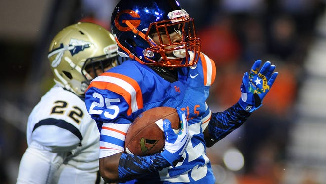 Bishop Gorman Gaels wide receiver Tyjon Lindsey (25) runs with the ball during a game against the St. John Bosco Braves at Fertitta Field in September of 2014.